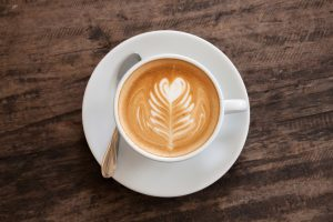 Cup of coffee with heart latte art