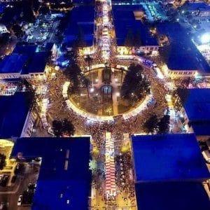 Drone footage of Orange International Street Fair at night