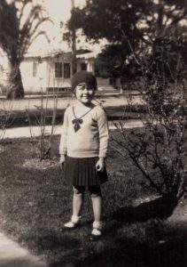 Shirley M. Perkins in front of her childhood home at 343 N. Cleveland St.